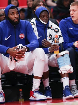 Andre Drummond, left, and Reggie Jackson on the bench in the fourth quarter of the Pistons' 105-96 win over the Bucks on Friday.