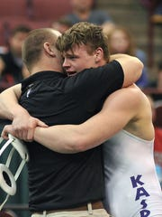 Lexington's Drew Kasper gets a hug from coach Andrew Heath after winning a 2015 state championship.
