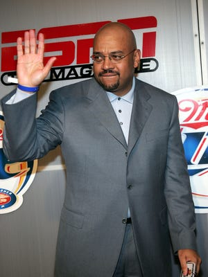 ESPN TV personality Michael Wilbon is shown. Wilbon was a longtime columnist at The Washington Post and attended Northwestern.
