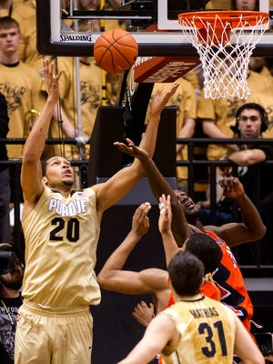 Purdue center A.J. Hammons (20) goes after a rebound against Illinois center Nnanna Egwu (32) during the second half of an NCAA college basketball game, Saturday, March 7, 2015, in West Lafayette, Ind. Purdue won 63-58. (AP Photo/Doug McSchooler)