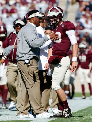 Texas A&M Aggies head coach Kevin Sumlin (left) talks with quarterback Kyle Allen (10) after a touchdown against the Louisiana Monroe Warhawks during the first quarter at Kyle Field on Nov. 1, 2014.