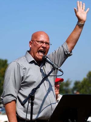 Rev. Randy Smith spoke during a protest in support of Kim Davis outside the Carter County Detention Center in Grayson, Ky. Sept. 5, 2015