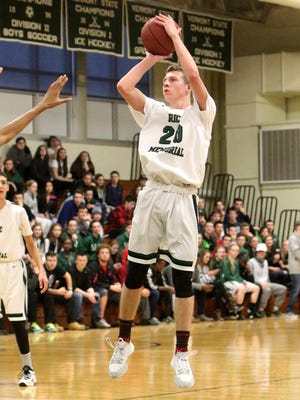 Rice sophomore Elliott Nelson hits a jumper during the Green Knights' win over Mount Anthony on Saturday.