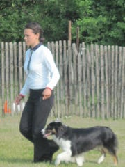 Showmanship winner Jubilee Morgan with her dog Braya won first blue in senior showmanship, grades 9 and over.