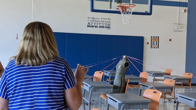 Shelley Golden, fourth grade teacher at Steele Elementary, observes a model that shows how far respiratory droplets containing the novel coronavirus can travel in a maskless environment.