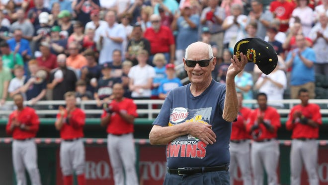WW II veteran Charlie Tozier acknowledges the cheering crowd as he is introduced before the start of the Twins vs Red Sox spring training game Tuesday at Hammond Stadium.