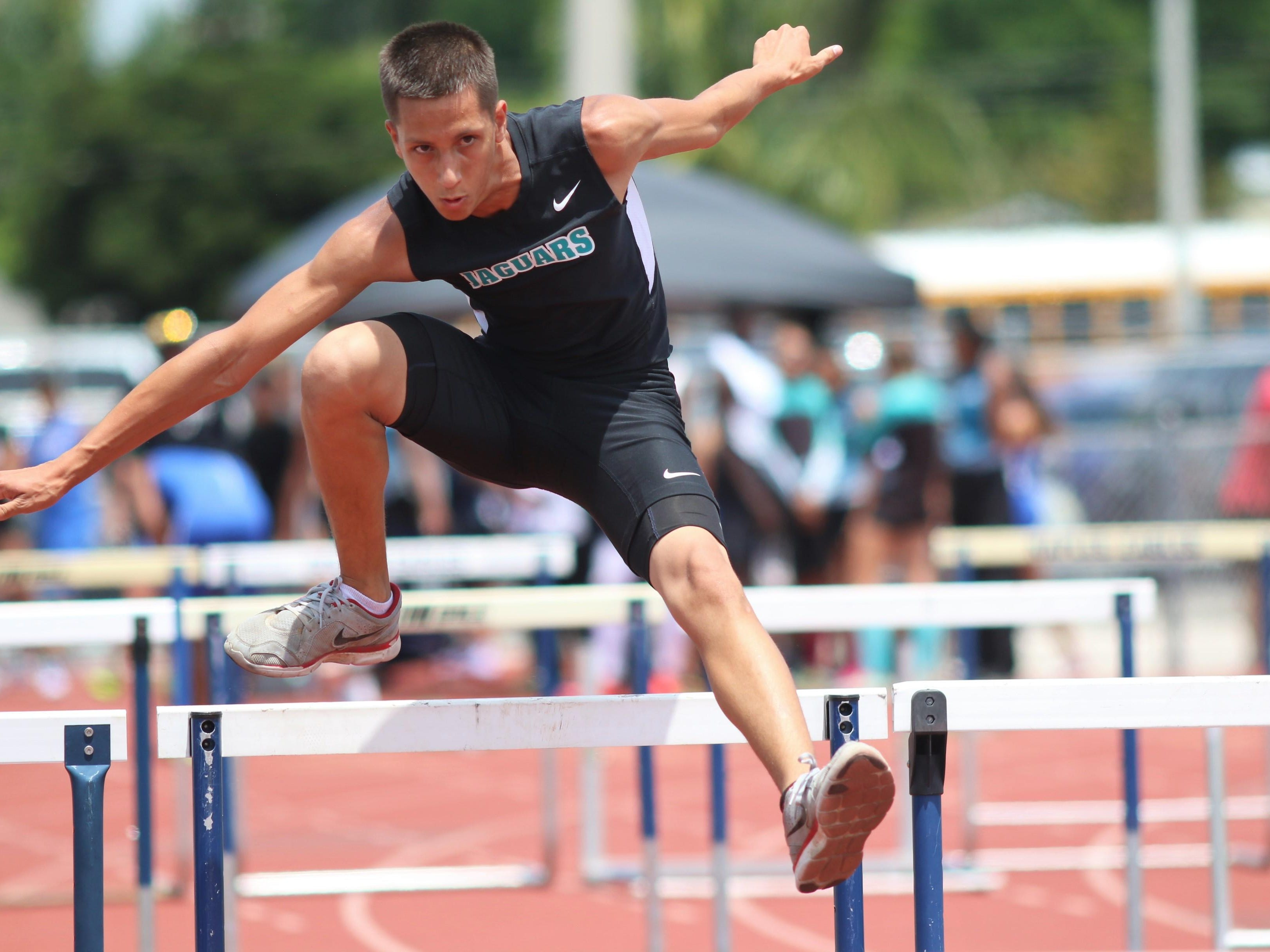 East Lee's David Garcia clears a hurdle during the 110-meter hurdle at Saturday's Class 3A District 12 track meet at Naples High.