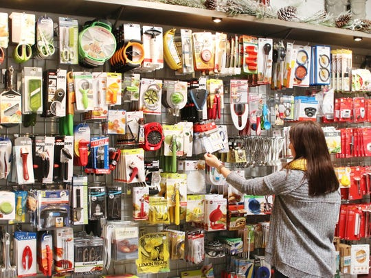 A customer browses the gadgets wall at the new Cooking Gallery in Arlington Gardens.