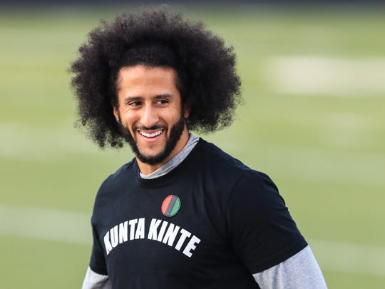 RIVERDALE, GA - NOVEMBER 16: Colin Kaepernick looks on during a private NFL workout held at Charles R Drew high school on November 16, 2019 in Riverdale, Georgia. Due to disagreements between Kaepernick and the NFL the location of the workout was abruptly changed.  (Photo by Carmen Mandato/Getty Images)