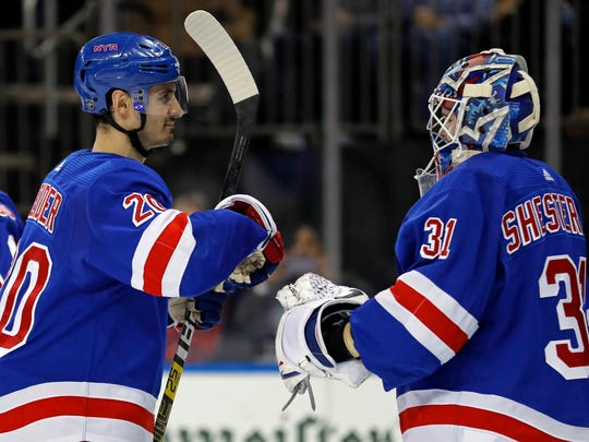 New York Rangers left wing Chris Kreider congratulates goaltender Igor Shesterkin (31) after defeating the Los Angeles Kings in an NHL hockey game Sunday, Feb. 9, 2020, in New York. The Rangers won 4-1. (AP Photo/Adam Hunger)