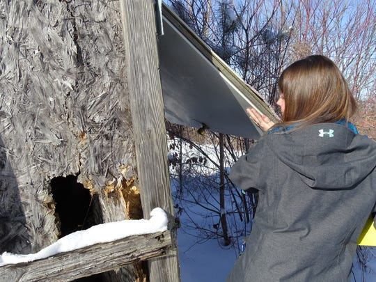 Stacey Seif from Volunteers of America looks into an abandoned structure off Ohio 545 and U.S. 30 that may be used as a temporary shelter by homeless people.