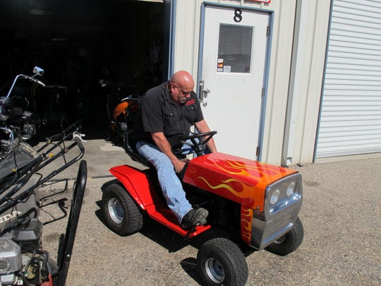A racer inspects his lawn mower before a race at last year's Beaver Dam Jam.