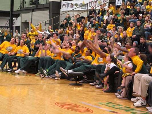 Members of the North Dakota State men's basketball team and fans react Sunday, March 14, 2014, in Fargo, N.D., as the Bison were selected to play Oklahoma Thursday  in the first game of the NCAA Division I tournament. The game will be in Spokane, Wash. (AP Photo/Dave Kolpack)