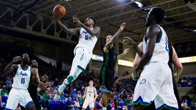 Florida Gulf Coast University junior, Brandon Goodwin, goes in for a layup after a quick turn over during the game against Florida National University at Alico Arena in Estero, Fla. on Thursday, December 22, 2016. The Eagles beat Florida National University, 107 to 50.