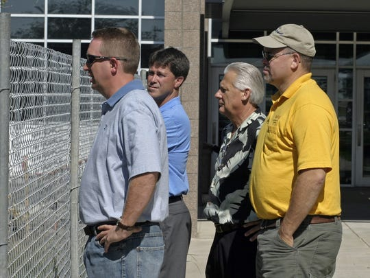 Eric Rose, front left, examines progress on construction at Waukee High School in this file photo from 2006. Rose, now the district's chief operating officer, is at the center of a lawsuit filed by a former district employee. Also pictured, from left, are former Superintendent Dave Wilkerson, former Director of Administrative Services Duane Van Gorp and former school board member Larry Lyon.