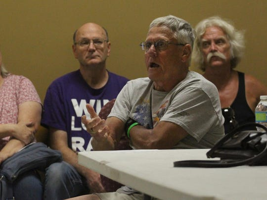 Neighborhood resident Dale Millard gestures while voicing his concerns as about 30 people attended a Daily Herald Media listening session at the Salvation Army on Wausau's west side, Wednesday, July 29, 2015.