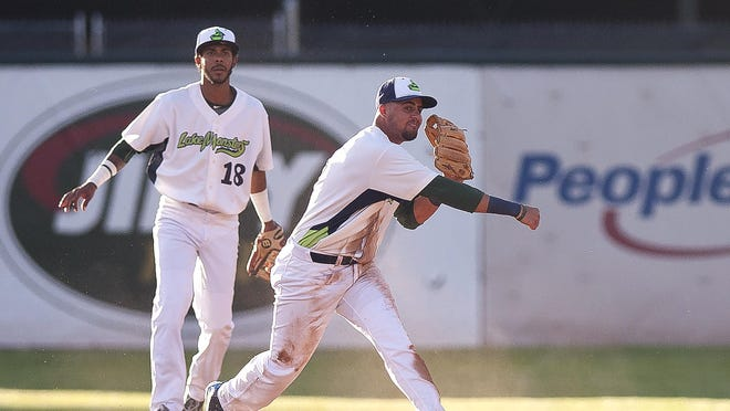 Vermont Lake Monsters third baseman Javier Godard, center, makes a throw to first base against Brooklyn during Wednesday night's game at Centennial Field.