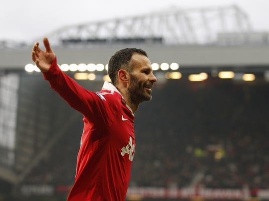 FILE - In this Saturday, Jan. 22, 2011 file photo, Manchester United's Ryan Giggs celebrates after scoring against Birmingham during the English Premier League soccer match at Old Trafford Stadium, Manchester, England. Manchester United great Ryan Giggs has ended his playing career after a club-record 963 appearances. Giggs made the announcement in an open letter on United's website on Monday, May 19, 2014,  the day he was hired as assistant manager to Louis van Gaal. (AP Photo/Jon Super, File)