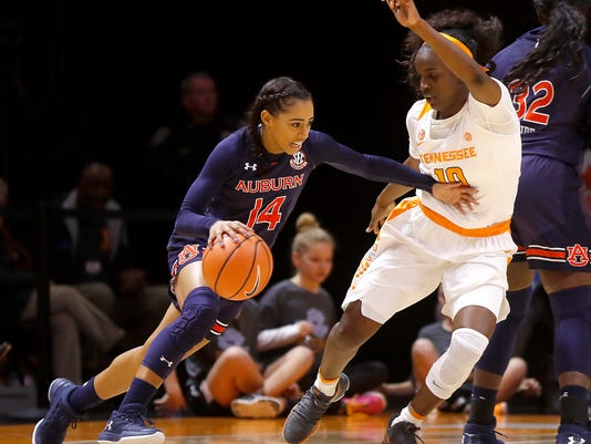 Auburn's Tiffany Lewis (14) drives against Tennessee's Meme Jackson (10) during an NCAA college basketball game Thursday, Jan. 4, 2018, in Knoxville, Tenn. (Daryl W Sullivan/The Daily Times via AP)