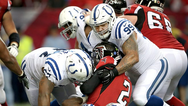 Atlanta Falcons quarterback Matt Ryan (2) is sacked by Indianapolis Colts inside linebacker D'Qwell Jackson (52), Billy Winn (99) and  T.Y. McGill (67) in the second half of their game. The Indianapolis Colts play the Atlanta Falcons Sunday, November 22, 2015, afternoon at the Georgia Dome in Atlanta GA.