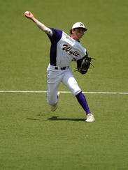Wylie shortstop Zach Smith (39) throws out a baserunner