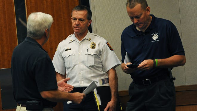 From left, IAFF President Dennis Jacobsen, acting Fire Chief Dave Cochran and IAFF Vice-President Tom Dunn talk before the start of a press conference at Reno City Hall on May 21, 2015.
