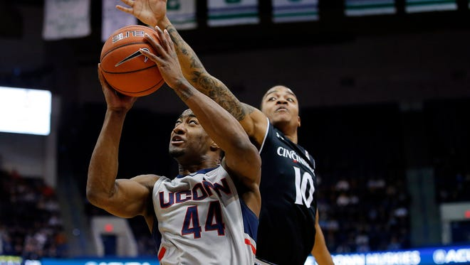 Connecticut Huskies guard Rodney Purvis (44) shoots against Cincinnati Bearcats guard Troy Caupain (10) in the first half at XL Center.
