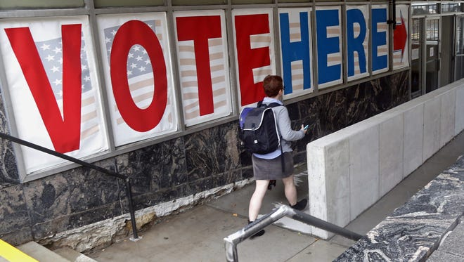 A woman at an early-voting site in Minneapolis. The deadline to register to vote is Saturday in Delaware.