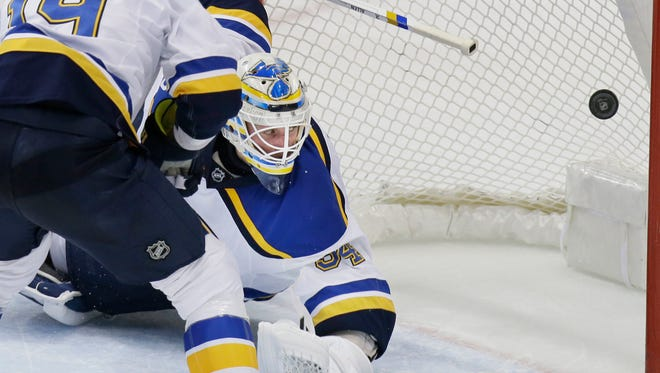 St. Louis Blues goalie Jake Allen (34) and defenseman Jay Bouwmeester (19) can't stop a goal scored by Dallas Stars center Jason Spezza, not shown, during the second period of an NHL hockey game in Dallas, Tuesday, Dec. 20, 2016. (AP Photo/LM Otero)