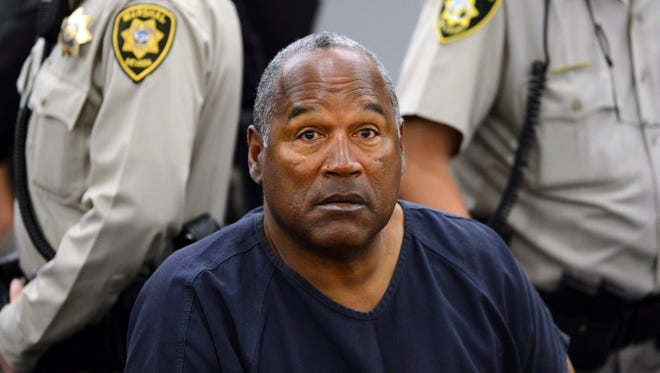 In this May 14, 2013 pool file photo, O.J. Simpson sits during a break on the second day of an evidentiary hearing in Clark County District Court in Las Vegas. Simpson, the former football star, TV pitchman and now Nevada prison inmate, will have a lot going for him when he appears before state parole board members Thursday, July 20, 2017 seeking his release after more than eight years for an ill-fated bid to retrieve sports memorabilia.