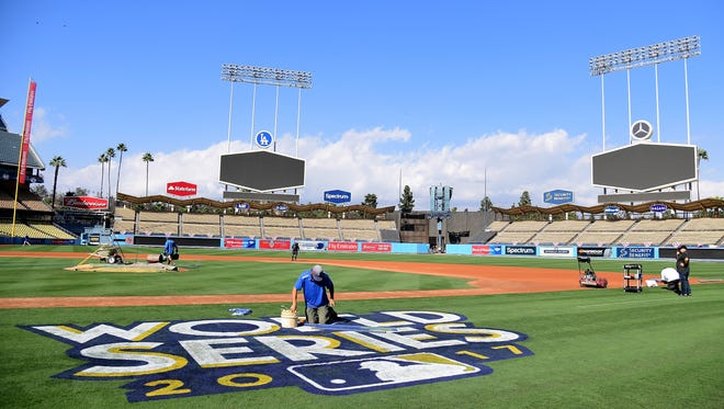 The World Series logo is painted on the field at Dodger Stadium on Friday. For the first time since 1988, the Dodgers will host a World Series game Tuesday.