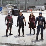 "Anthony Mackie, left, Paul Rudd, Jeremy Renner, Elizabeth Olsen, Chris Evans and Sebastian Stan suit up for the superhero smash-up ""Captain America: Civil War."""