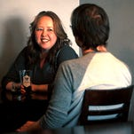 Heidi Kerr-Schlaefer, co-owner of Ryan Schlaefer Fine Furniture, shares a beer with her husband, Ryan, in this 2012 file photo. Ryan Schlaefer Fine Furniture has moved to a new Loveland location.