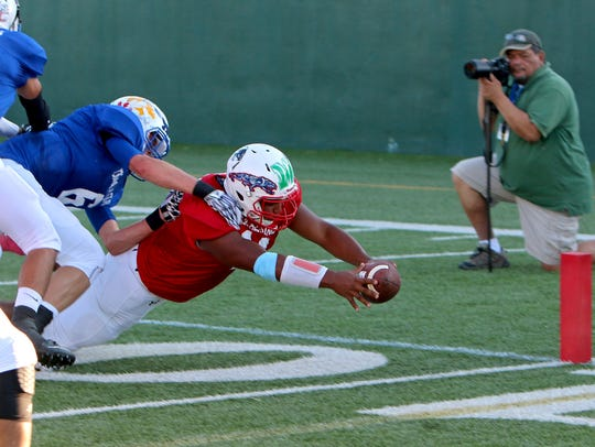 Bishop Norman of Zephyr stretches out for the end zone