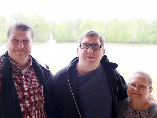 April 20, 2018 - Joe and Gayle Ennis with their son, Mark, center. Mark's Park is named after the 36-year-old who has autism.