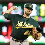 Oakland Athletics pitcher Ryan Cook pitches against the Minnesota Twins in the eighth inning of a baseball game in Minneapolis. Right-hander Ryan Cook has agreed to a one-year contract with the Seattle Mariners, who added another arm to their overhauled bullpen, Thursday, Jan. 6, 2016.