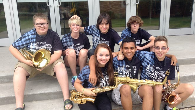 These 15-year-old students participated in the D.C. Everest Summer Jazz Band Camp this summer, but next year they will be teaching assistants. Sitting on the school steps are Logun Gunderson of Weston, top row, from left, Molly Sanders of Weston, Duncan Cofell of Appleton and Shawn Wilde of Weston; and bottom row, Mikayla Finnegan of Weston, Oscar Patino of Wausau and Isaac Guralski of Schofield.