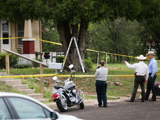 Investigators from several law enforcement agencies examine the scene of a double-homicide in the 1000 block of Rio Grande Street on Sept. 12, 2016.