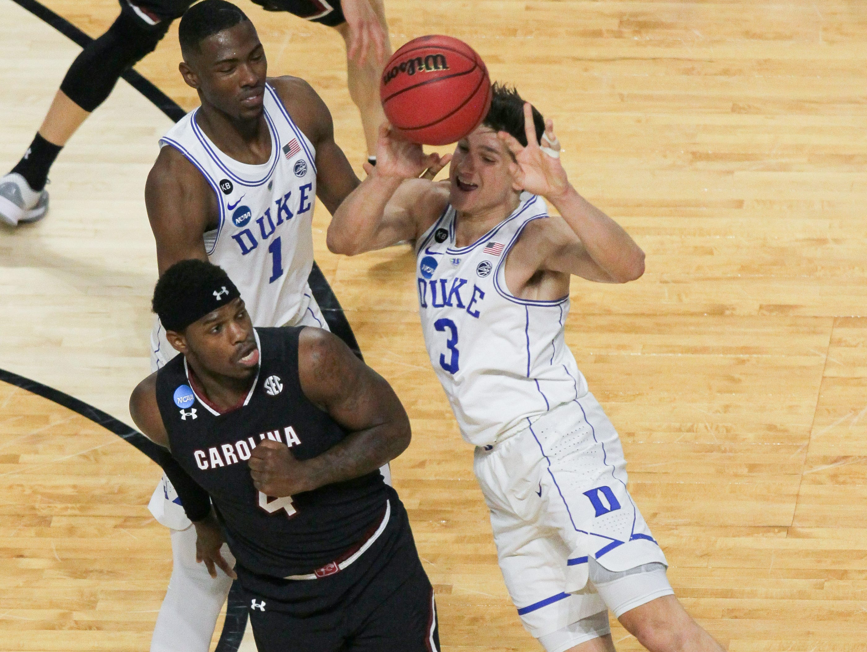 Duke guard Grayson Allen (3) passes near South Carolina guard Rakym Felder (4) in the first half during the 2nd round of the NCAA Tournament at Bon Secours Wellness Arena in downtown Greenville on Sunday, March 19, 2017.