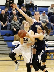 Taylor Kelly of Watkins Glen goes up for a shot as