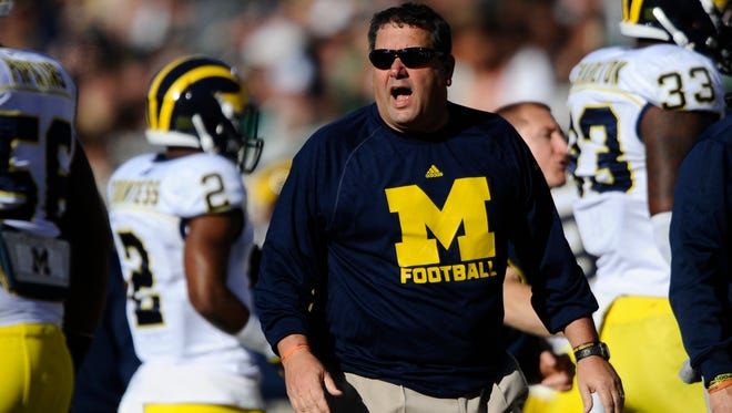 Michigan coach Brady Hoke shouts out instructions to his team in the second quarter of Saturday's loss to Michigan State in East Lansing.