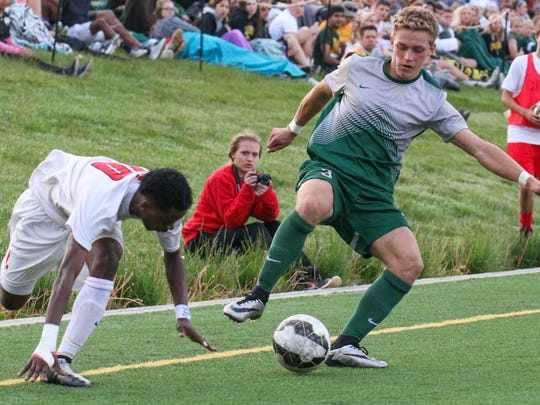 West High's Alex Anderson steals the ball from City