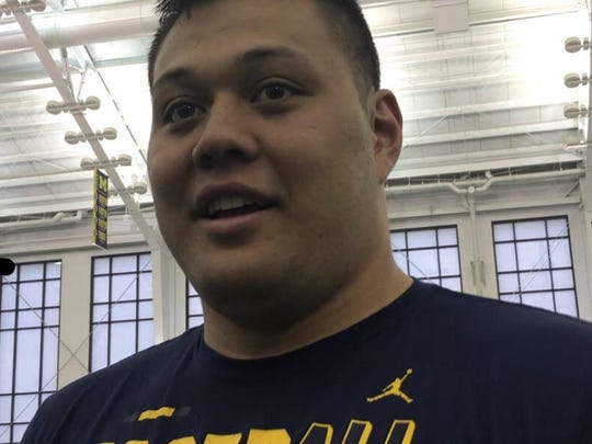 Michigan offensive lineman Chuck Filiaga speaks with reporters in Ann Arbor on June 9, 2018.