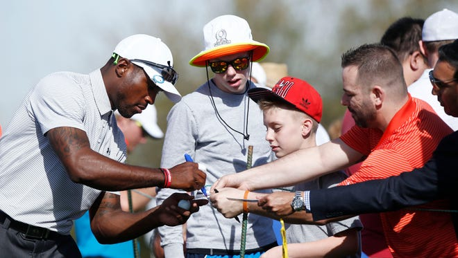 Arizona Cardinals Patrick Peterson signs his autograph for Scotty and CJ Shaver at the Annexus Pro-Am at the Waste Management Phoenix Open at TPC Scottsdale on Wednesday, Jan. 28, 2015.