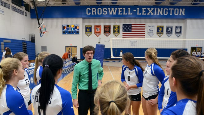 Head coach Ryan Wilson talks to his team after winning 3-0 Monday, Nov. 2, against Imlay City during district volleyball at Cros-Lex.