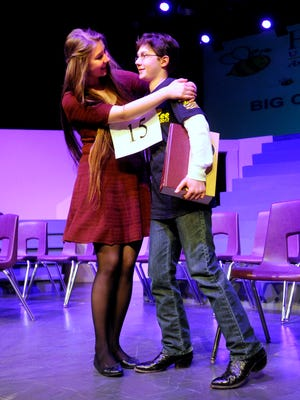 Spelling bee champion Jack Miller gets a hug from his sister, Kate, a former spelling bee champion after Miller won his third straight Big Country Spelling Bee on Saturday, March 25, 2017, at Hardin-Simmons University's Van Ellis Theater.