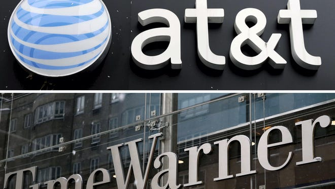 A combo file picture shows an AT&T store (top) in New York City, New York, USA, on 04 December 2008, and a view of the Time Warner Center (bottom) in New York City, New York, on Feb. 13, 2014.