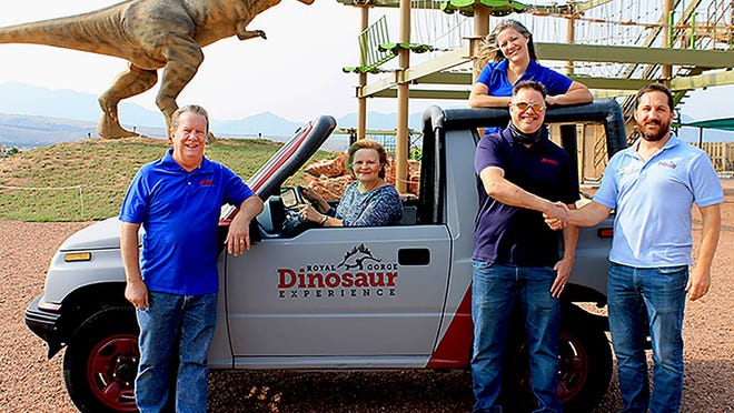 Royal Gorge Dinosaur Experience Owner Zach Reynolds (far right) accepts the tricked out 1991 Chevy Tracker from the Zerby Automotive crew including (from left) Keven Zerby, Jodee Zerby, Rachel Lutz and Ronald Lutz.