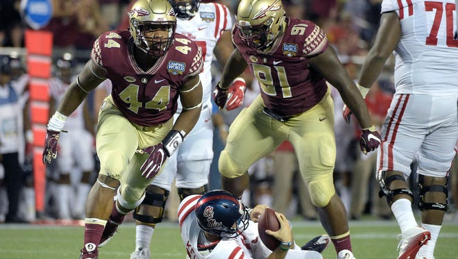 Florida State defensive end DeMarcus Walker (44) and defensive tackle Derrick Nnadi (91) celebrate after sacking Mississippi quarterback Chad Kelly (10) during their season opener on Sept. 5.