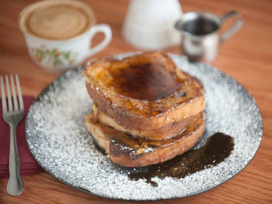 Milk bread French toast, maple syrup, and powdered